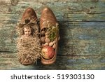 Small photo of Child Jesus in clog crib and offering on old wooden background with blank space.