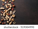 various nuts on stone table.... | Shutterstock . vector #519304990