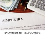 Small photo of Papers with simple ira and book on a table.