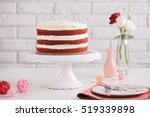 delicious cake on white table | Shutterstock . vector #519339898