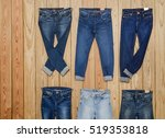 Collection Six Jeans On Wooden...