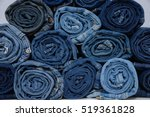 Roll Blue Denim Jeans Arranged...