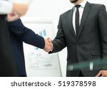 investor shakes hands with the... | Shutterstock . vector #519378598