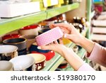 Stock photo hands of young woman selecting bowl in pet shop close up view 519380170