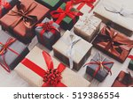 lots of gift boxes on wood... | Shutterstock . vector #519386554