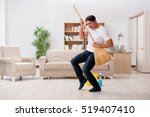 man cleaning home with broom | Shutterstock . vector #519407410