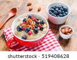 bowl of oatmeal porridge with... | Shutterstock . vector #519408628