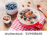 bowl of oatmeal porridge with... | Shutterstock . vector #519408640