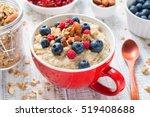 bowl of oatmeal porridge with... | Shutterstock . vector #519408688