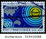 "Small photo of BANGKOK, THAILAND - OCTOBER 08, 2016: A postage stamp printed in Japan shows map of asia oceania region and symbol of ADB, series ""20th annual conference of asian development bank "", circa 1987."
