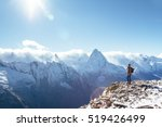 man with backpack trekking in... | Shutterstock . vector #519426499