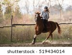 Stock photo young pretty girl riding a horse 519434014