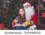 christmas. happy girl sitting... | Shutterstock . vector #519448510