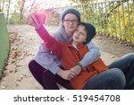 friends or siblings on footpath ... | Shutterstock . vector #519454708