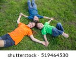 three smiling happy kids lying... | Shutterstock . vector #519464530