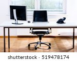 Stock photo modern empty office space desk with computer phone and chair concept of corporate job vacancy 519478174
