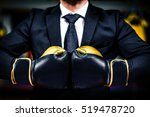 Businessman With Boxing Gloves...