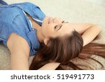 beautiful girl relaxing on floor | Shutterstock . vector #519491773