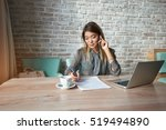 businesswoman talking on cell... | Shutterstock . vector #519494890