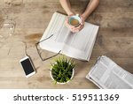 reading newspaper on wooden... | Shutterstock . vector #519511369