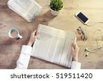 reading newspaper on wooden... | Shutterstock . vector #519511420