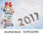 christmas cookies on snowy... | Shutterstock . vector #519522490