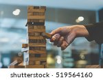 hand of businessman placing or... | Shutterstock . vector #519564160