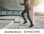 Stock photo businessman running fast upstairs horizontal outdoors shot 519567250