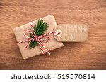 Hand Wrapped Gift On Wooden...