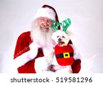 Santa Claus Smiles As He Holds...