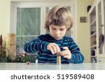 little boy playing with coins... | Shutterstock . vector #519589408