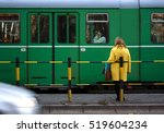 Woman In Yellow Coat And A...