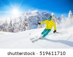 skier skiing downhill in high... | Shutterstock . vector #519611710
