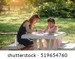 mother is teaching daughter... | Shutterstock . vector #519654760