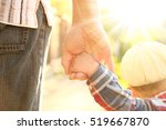 the parent holds the hand of a... | Shutterstock . vector #519667870