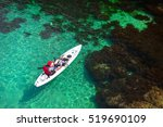 fisherman catches a fish on a... | Shutterstock . vector #519690109