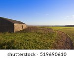 A Farm Building Overlooking A...