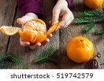 Tangerine And Fir Branches In...