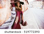 smiling girl in a hat walking... | Shutterstock . vector #519772393