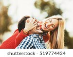 young happy couple is enjoying... | Shutterstock . vector #519774424
