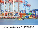 tugboat and crane in harbor... | Shutterstock . vector #519780238