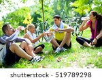 four people relaxing after a... | Shutterstock . vector #519789298