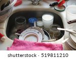 dirty dishes in a kitchen sink   Shutterstock . vector #519811210