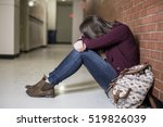 Stock photo a young depress female student at the college 519826039