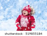 baby playing with snow in... | Shutterstock . vector #519855184
