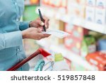 woman doing grocery shopping at ... | Shutterstock . vector #519857848