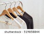 ladies blouses on wooden... | Shutterstock . vector #519858844