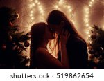 young couple kissing near... | Shutterstock . vector #519862654