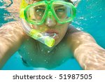 Man snorkeling underwater close-up portrait - stock photo