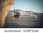 a rock climber rappelling past... | Shutterstock . vector #519875260